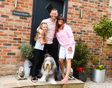 James' family in front of their self-build home