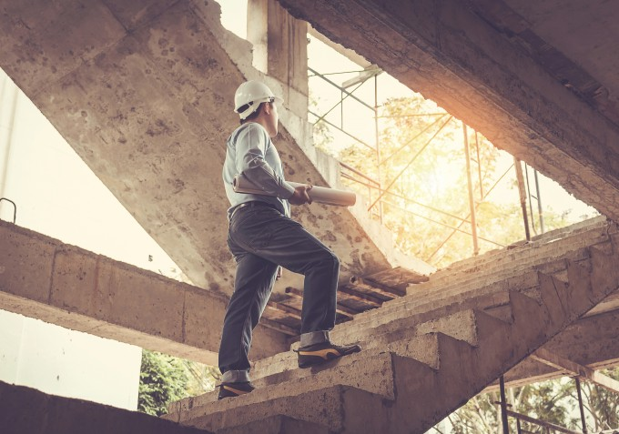 Builder climbing stairs