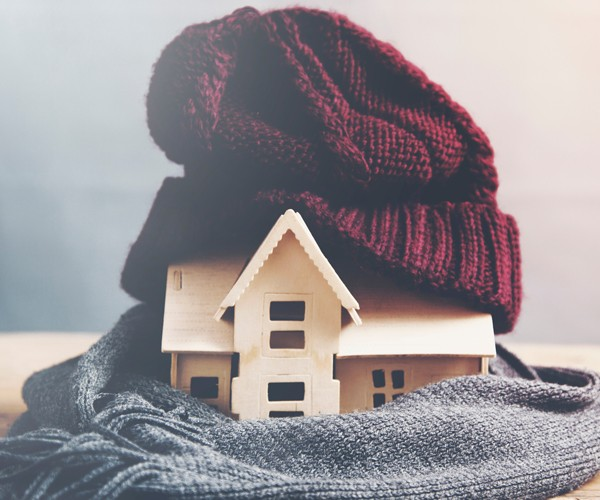 House wrapped in hat and scarf