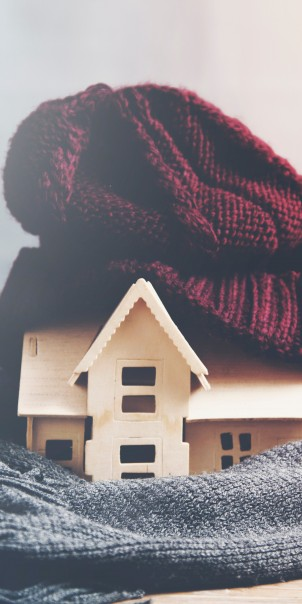 House wrapped in a hat and scarf